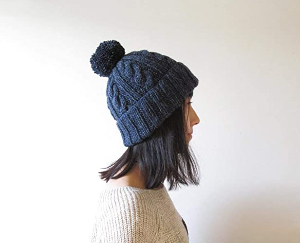 180b9fea95713 Amazon.com  Cable Knit Hat in Jaspe Navy