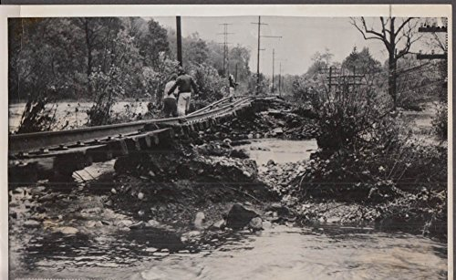 Rr Tracks (New Haven RR tracks twisted Cannondale CT after 1955 Flood news photo)