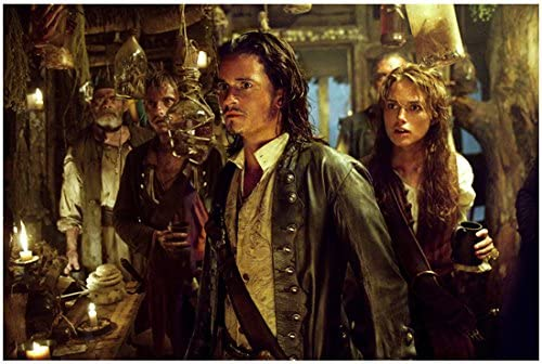 Pirates of the Carribean Orlando Bloom as Will Turner with Keira Knightley  as Elizabeth Swann in Calyso's Lair 8 x 10 Photo at Amazon's Entertainment  Collectibles Store