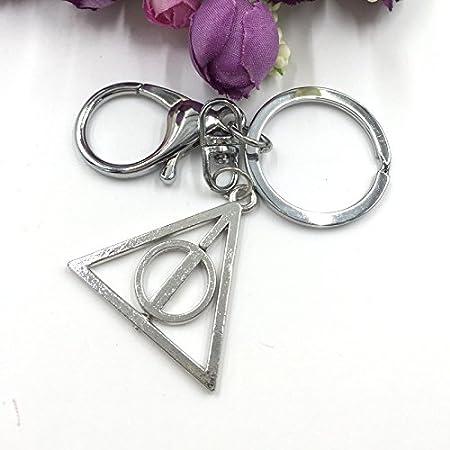Llavero triangular con diseño giratorio de «Las reliquias de ...