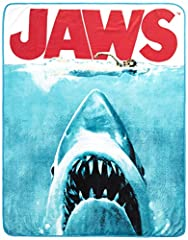 The Silver Buffalo JW0127 Jaws Movie Poster Throw Blanket won't make it any safer to go back in the water, but it is perfect for cuddling while watching your favorite Shark terrify summer tourists. Cuddle up at home, in the car, or at sportin...