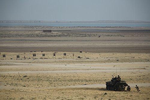 - LAMINATED POSTER U.S. Marines with the 1st Light Armored Reconnaissance detachment, Battalion Landing Team 2nd Batta