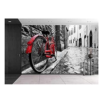 Retro Vintage Red Bike on Cobblestone Street in...