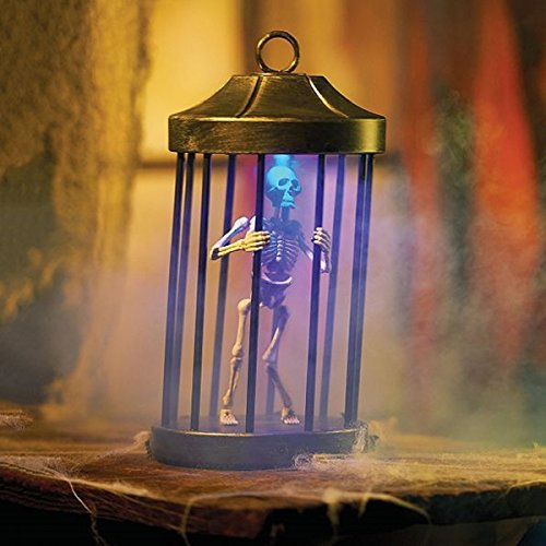 ghi Animated Raging Skeleton in A CAGE Halloween Decoration]()