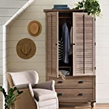 Armoire Garment Hanging Rod and Storage Cubbyholes Behind Louver Detailed Doors Which Fold Back Against End Panels Paper Board Back Material