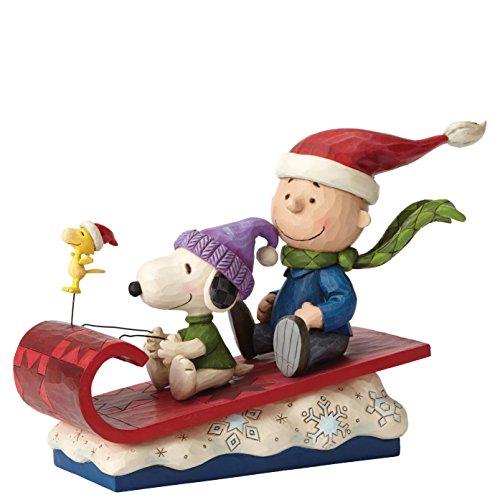 (Enesco 4052726 Peanuts by Jim Shore Charlie Brown on Sleigh Stone Resin Figurine)
