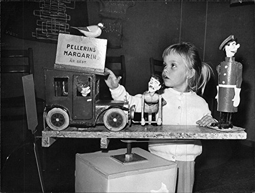 Vintage photo of 4-year-old Ingrid Eriksson views an unusual windmill at the hobby exhibition in Bollmora center