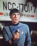 Leonard Nimoy Signed / Autographed Star Trek 8x10 glossy photo portraying Spock. Includes FANEXPO Certificate of Authenticity and Proof. Entertainment Autograph Original.