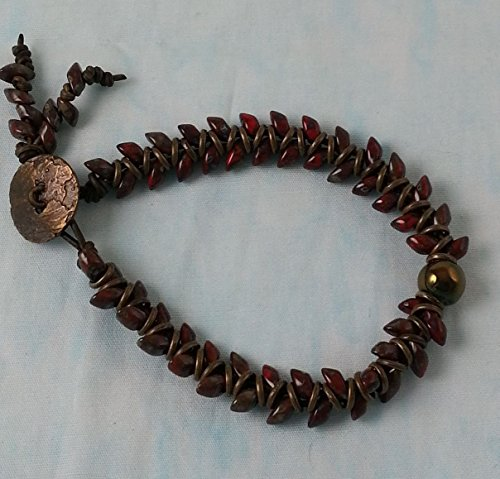 Boho Artisan Barnside Earthtone and Red Leafy Spine Design Leather Woven Bracelet. Copper Raku Focal Accent Bead on soft leather with antique brass rings and a button clasp.