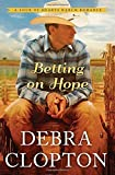 img - for Betting on Hope (A Four of Hearts Ranch Romance) by Debra Clopton (2015-02-24) book / textbook / text book