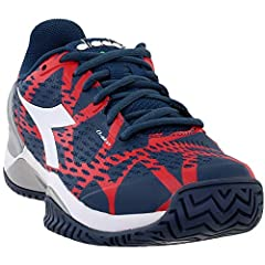 A Tennis Shoe Created With Innovative Blushield Technology, Designed To Ensure Total Grip Of The Foot And Perfect Balance Of The Body, Thanks To The Use Of Special Active Cones And An Ergonomic Morpho Base. The Upper, Featuring Air Mesh And S...