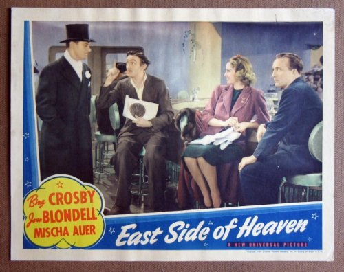 CZ15 East Side Of Heaven BING CROSBY 1939 Lobby Card.  Here's a terrific lobby card from the original release of EAST SIDE OF HEAVEN featuring a great image of BING CROSBY and JOAN BLONDELL.    Lobby card is in excellent plus condition. No pinholes, no stains, no tears, a tiny pen mark on upper border and a little bit of smudging on upper right corner, lower right corner has been replaced.       A lobby card is an 11 x 14 inch placard advertising a movie. They were displayed in the theatre lobby to entice moviegoers to go to the box office and buy a ticket. (Pinhole Pen)