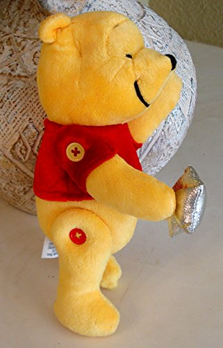 Winnie the Pooh Jointed Plush Holding a Silver Star with Buttons on Joints - 8 Inches]()