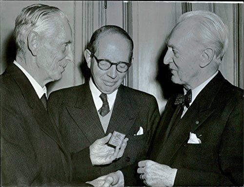 (Vintage photo of Three men with plaque at the meeting about the book