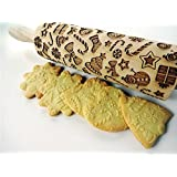 Rolling pin CHRISTMAS GIFTS. Wooden embossing rolling pin with CHRISTMAS GIFTS pattern. Embossed cookies. Pottery.