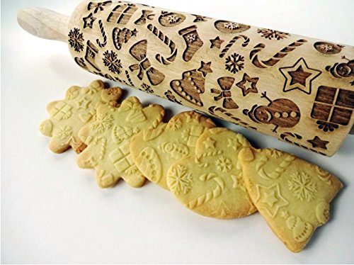 CHRISTMAS GIFTS embossing rolling pin. Embossing rolling pin with Christmas symbols. Christmas gingerbread cookies.