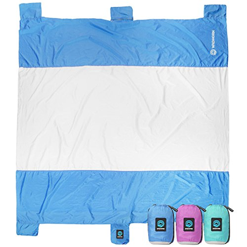 WildHorn Outfitters Sand Escape Beach Blanket. Compact Outdoor Beach Mat Made from Strong Parachute Nylon. Large 7 x 9 Size. Includes Built in Sand Anchors & Zippered Valuables Pocket.