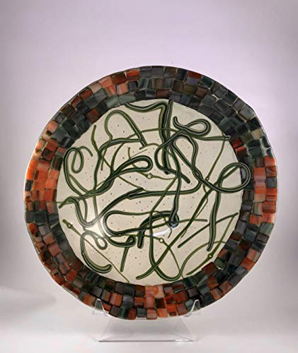 - 12 inch round fused glass bowl with swirls of green on clear and a mosaic green, creme and orange rim