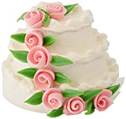 Darice timeless miniature 3 layer cake is great for your doll house. White tiered cake adorned with pink Roses and green leaves. There is 1 piece per package. Add this to any doll house and shadow box to celebrate a special occasion.