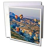 3dRose Danita Delimont - Travel - Turkey, Anatolia, Cappadocia, Goreme. Hot air balloons over Red Valley - 12 Greeting Cards with envelopes (gc_276995_2)
