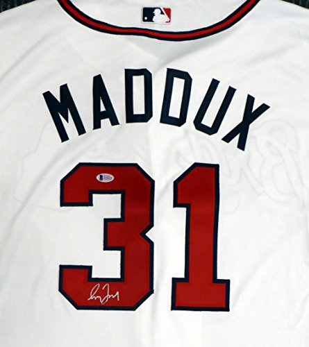ATLANTA BRAVES GREG MADDUX AUTOGRAPHED WHITE AUTHENTIC MAJESTIC COOL BASE JERSEY SIZE 48 BECKETT BAS STOCK #131233