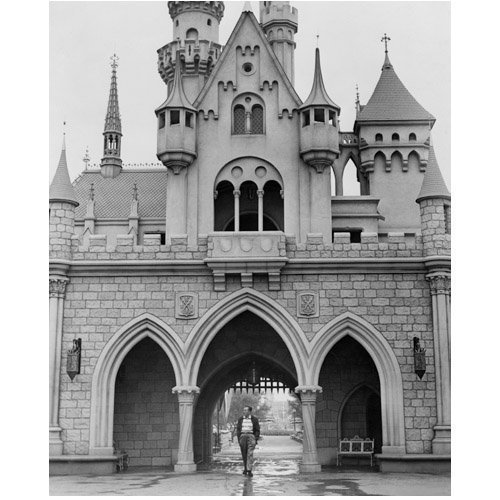 Walt Disney Taking a Stroll Under Sleeping Beauty's Castle 8 x 10 Inch Photo