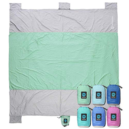 WildHorn Outfitters Sand Escape Beach Blanket. Compact Outdoor Beach Mat Made from Strong Parachute Nylon. Large 7 x 9 Size. Includes Built in Sand Anchors Zippered Valuables Pocket.