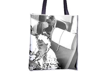 Judy Garland Holding con avión food. Allover impresa bolsos ...