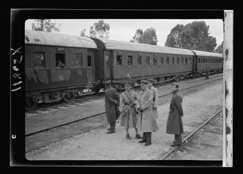 Photo: Men beside train