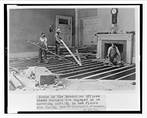 Historic Print (L): Scene at the executive offices where workmen are engaged in renovating, putting in new f