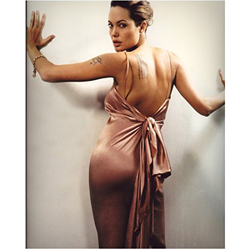 Angelina Jolie Backside View Wearing Pink Satin Dress Low Cut Back Tied in Back Head Turned Looking Back Hands on Wall Mouth Parted 8 X 10 Inch Photo