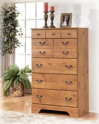 "Ashley Bittersweet B219-46 34"" 5-Drawer Chest with Replicated Pine Grain Details Decorative Hardware and Side Roller Glides in Light"