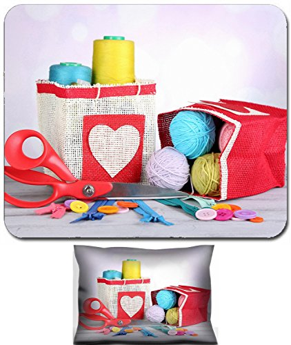 Luxlady Mouse Wrist Rest and Small Mousepad Set, 2pc Wrist Support design IMAGE: 26690255 Bags with bobbins of colorful thread and woolen balls on wooden table on light background