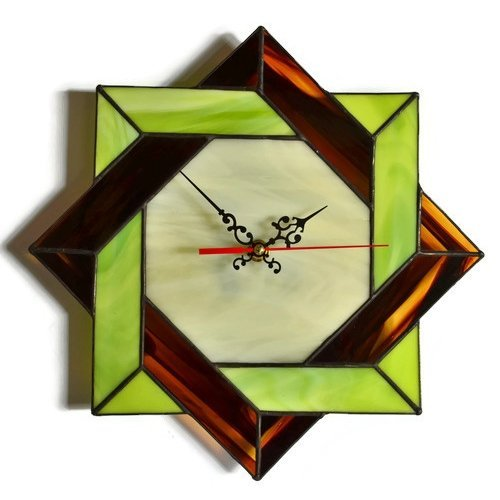 Modern wall clock made of stained glass with Celtic geometric design
