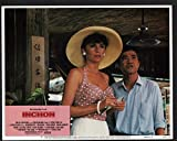 Inchon Lobby Card- Toshirô Mifune and Jacqueline Bisset wearing a big hat.