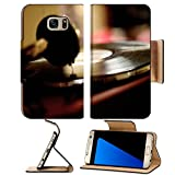 Luxlady Premium Samsung Galaxy S7 EDGE Flip Pu Leather Wallet Case IMAGE ID: 34821909 Horizontal shot of the vintage vinyl record player playing scratched LP