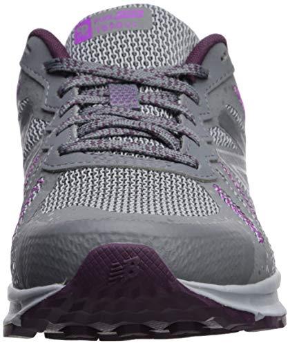 New Balance Women's 590v4 FuelCore Trail Running Shoe Gunmetal/Dark Current/Voltage Violet 5.5 B US by New Balance (Image #4)