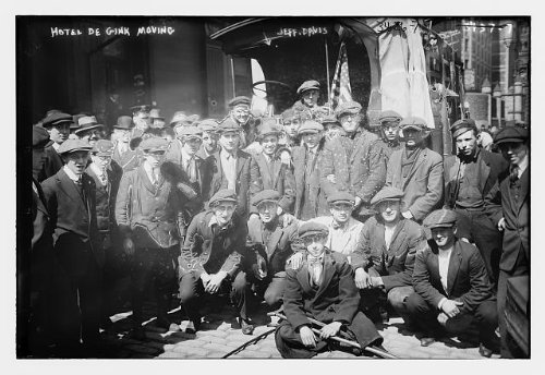 1915 Photo Hotel de Gink moving -- Jeff. Davis men seated outside the Hotel de Gink, a hotel for ''hobos'' and itinerant workers located at Centre and Worth Streets, the Bowery, New York City. (Source: