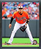 "Manny Machado Baltimore Orioles 2014 MLB Action Photo (Size: 12"" x 15"") Framed"