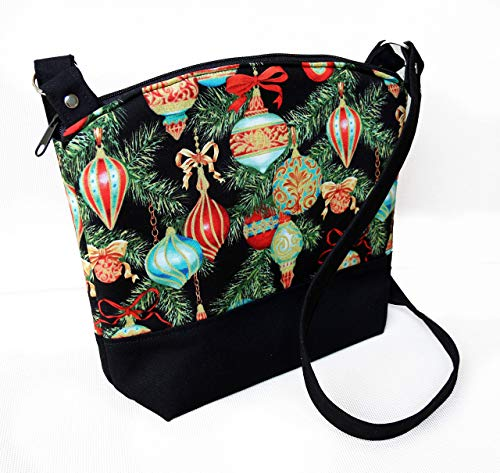 Christmas ornaments arm/cross body purse. Fully padded with foam and lined with black cotton fabric. With zipper and interior pockets. Washable and iron safe.