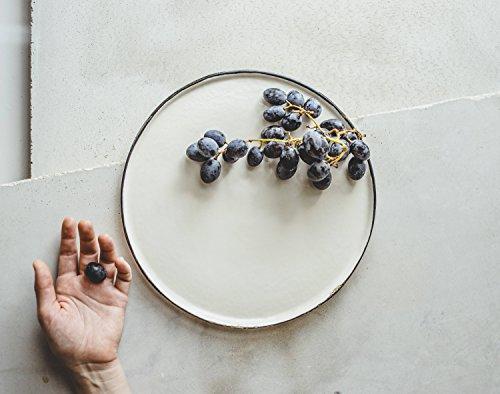 White porcelain and black rim dinner plate for a serving of salad, dessert or fruits by SIND STUDIO