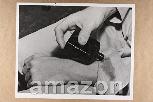 vintage-photo-of-man-putting-on-chigger-repellent-closeup-photo-ly486