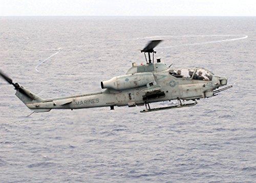 Cobra Helicopter Gunship (An AH-1W Super Cobra helicopter gunship approaches the flight deck of the amphibious assault ship U)