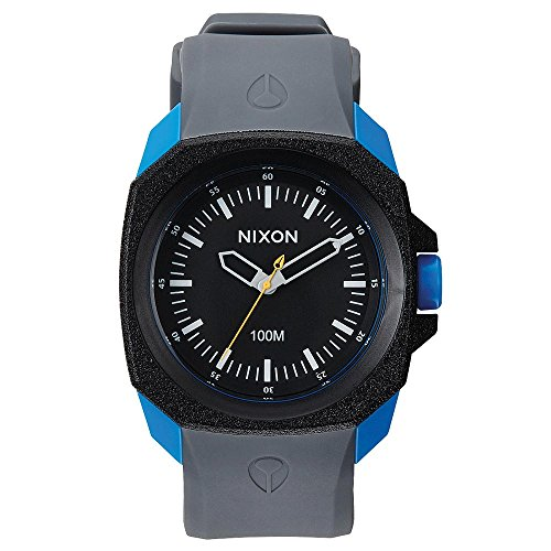 Blue polycarbonate case with a grey silicone strap. Fixed black plastic bezel. Black dial with skeleton hands and index hour markers. Minute markers around the outer rim. Dial Type: Analog. Quartz movement. Scratch resistant mineral crystal. ...