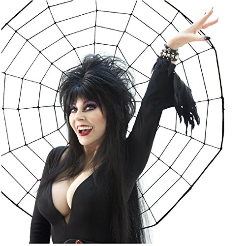 Cassandra Peterson is Elvira with Big Smile and Hand Up by Spiderweb 8 x 10 Inch Photo ()