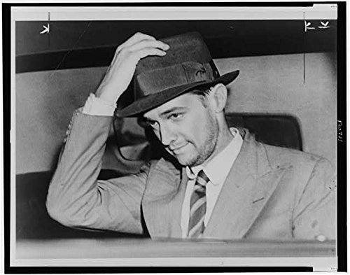 Photo: Howard Hughes,in car,holding his hat,after flight around the world,1938,Aviator
