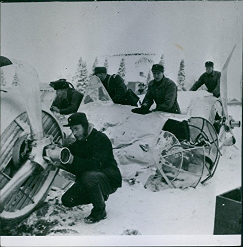 Vintage photo of krigskyte 1939-40 (war shooting 1939-40) Finnish aircraft mechanic in the process of investigating a downed Russian twin-engine bomber.