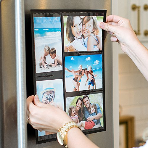 Hand shown sticking magnetic picture frames on a refrigerator.