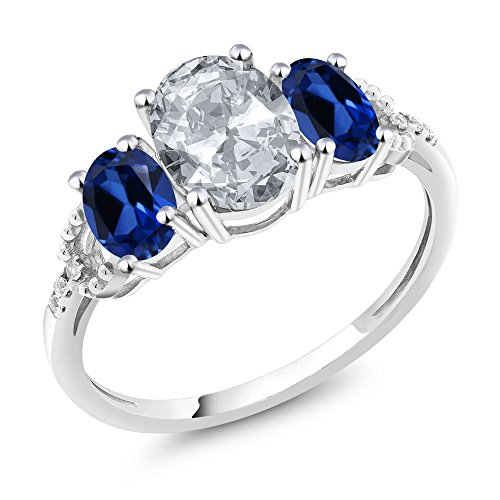 Gem Stone King 10K White Gold Diamond Accent 3-Stone Engagement Ring set with 2.35 Ct Oval White Topaz Blue Simulated Sapphire (Size - Sapphire Diamond & Ring