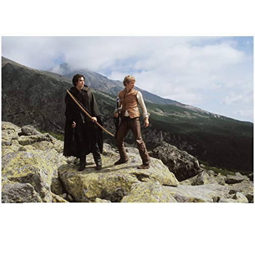 (Eragon Ed Speelers and Garrett Hedlund as Murtagh on Boulders Mountain Background 8 x 10 Inch Photo)